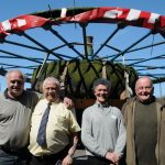 The old wheel brought back to the site (from left to right: Stuart Tomlins, John Wiltshire, John Larner, Glyn Jones)
